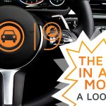 A car's dashboard, with the number 2019 stuck to it, symbolizing the automotive market of the year 2019 in this review article.